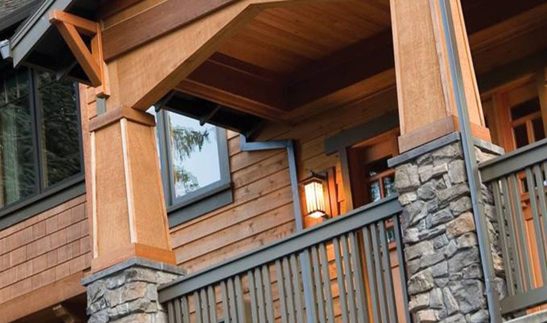 Mountain lodge with wood siding and metal railing