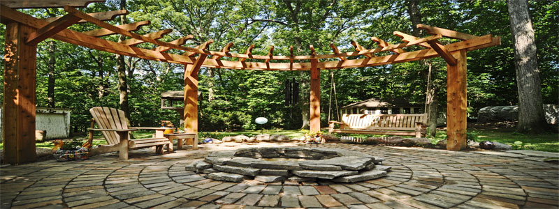 a circular pergola with a fire pit in the center