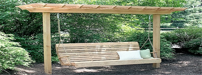 a 2 post pergola with a swing attached