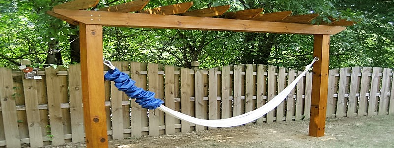 a 2 post pergola with a hammock attached