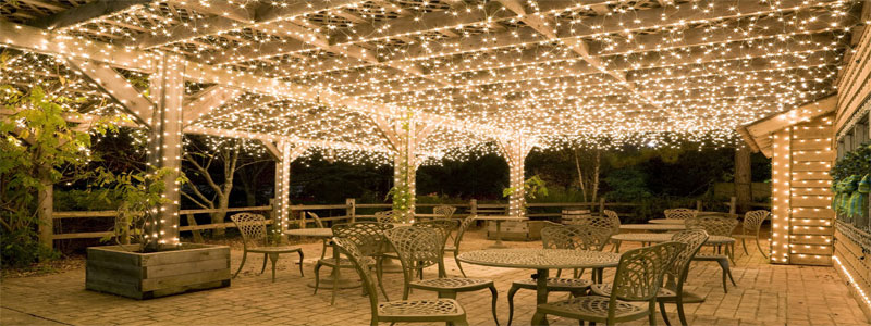 a lot of shiny pergola lights maybe for a wedding