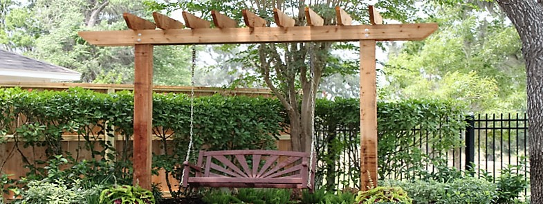 a 2 post pergola with a swing