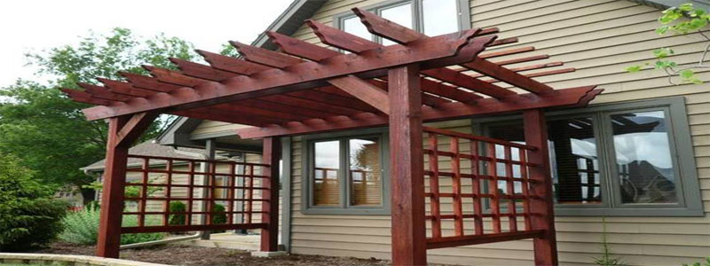 a dark red japanese pergola