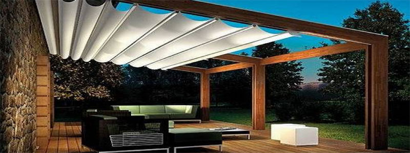 a modern pergola with top shades on sliders