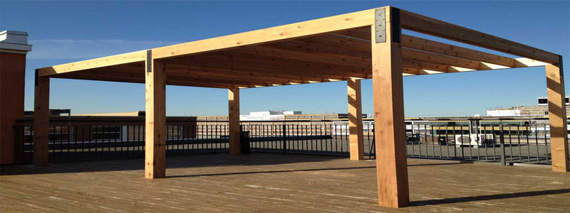 a modern square minimalist pergola made from wood