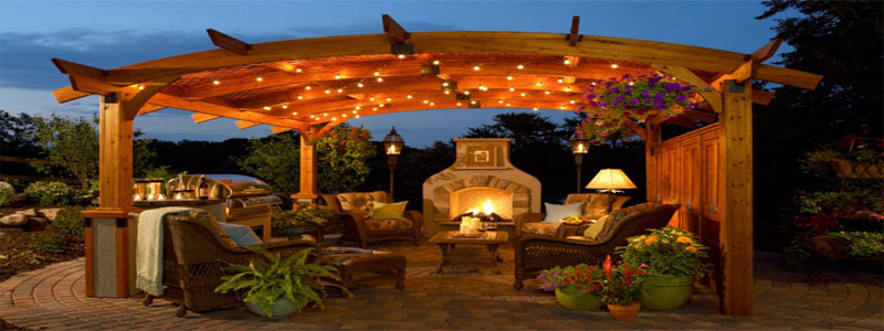 pergola with lights and a fireplace