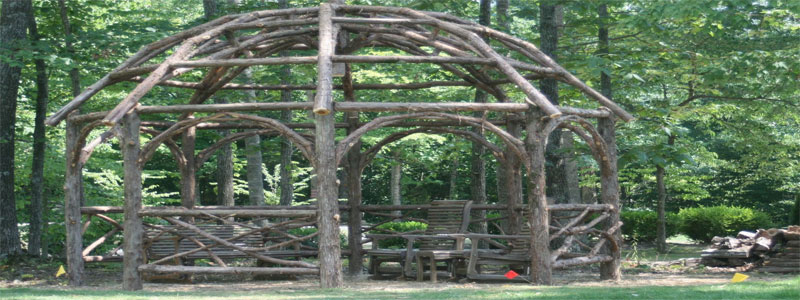 a dome shaped rustic pergola