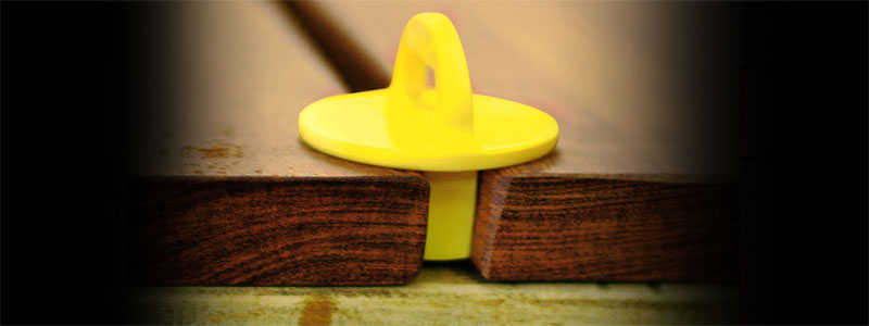 yellow plastic deck board spacer
