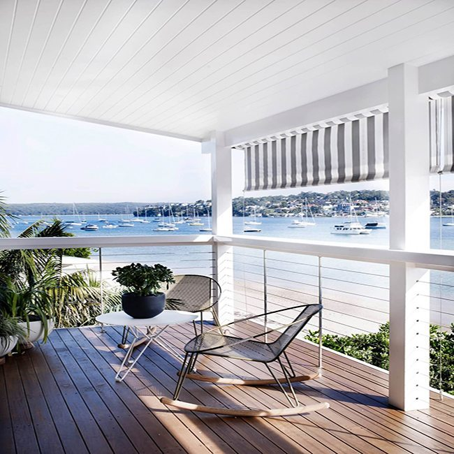 Outdoor deck with cable railing overlooking a bay