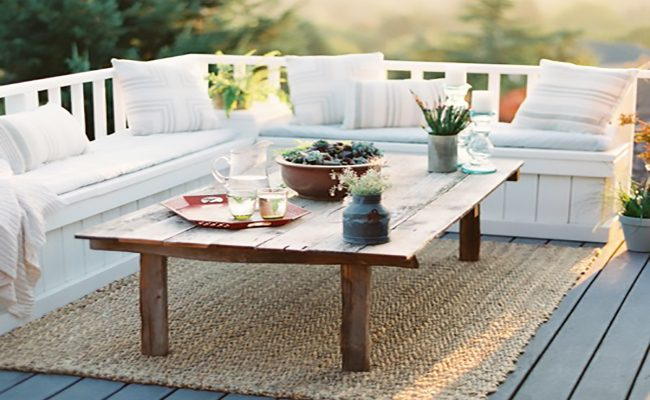Outdoor deck with seating and short table