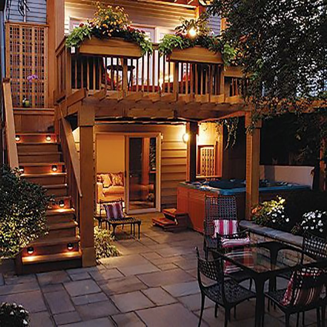 Raised outdoor deck and an outdoor living space