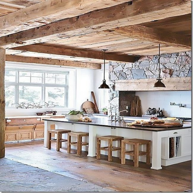 Rough hewn beams in rustic kitchen