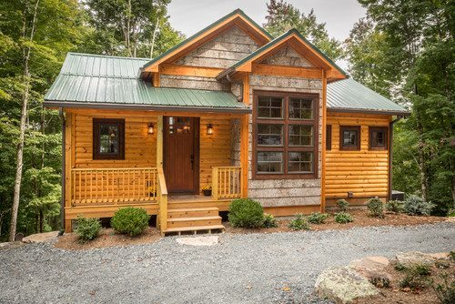 Small cabin with log lap siding